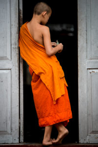 No matter where you go in Laos you will always encounter the vibrant orange of the monks.